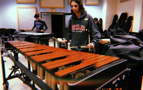 Senior Adam Corlito enjoys playing the marimba after school in the band room with his friends.