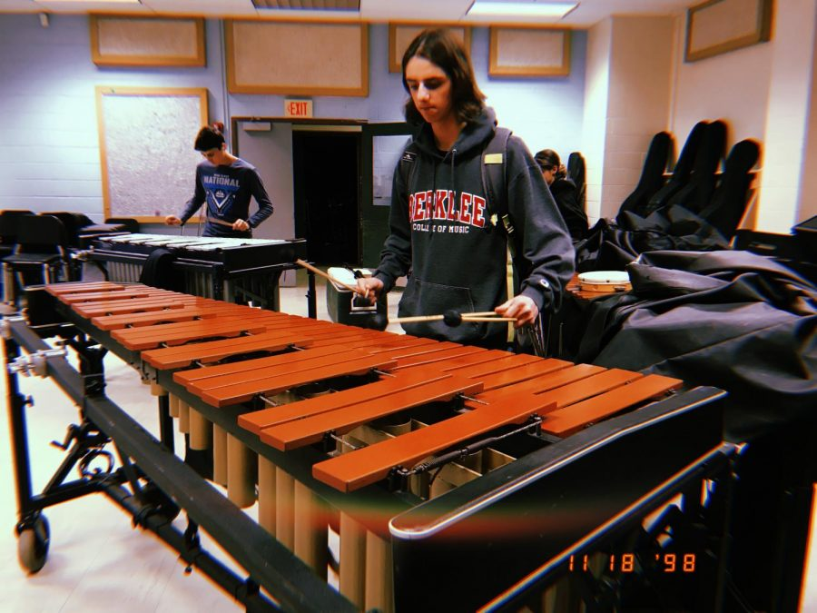 Senior+Adam+Corlito+enjoys+playing+the+marimba+after+school+in+the+band+room+with+his+friends.