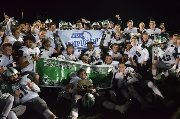 Hornets Football team celebrates victory at Natick High School after clinching the Division 2 South Championship against Number 1 seed Natick.