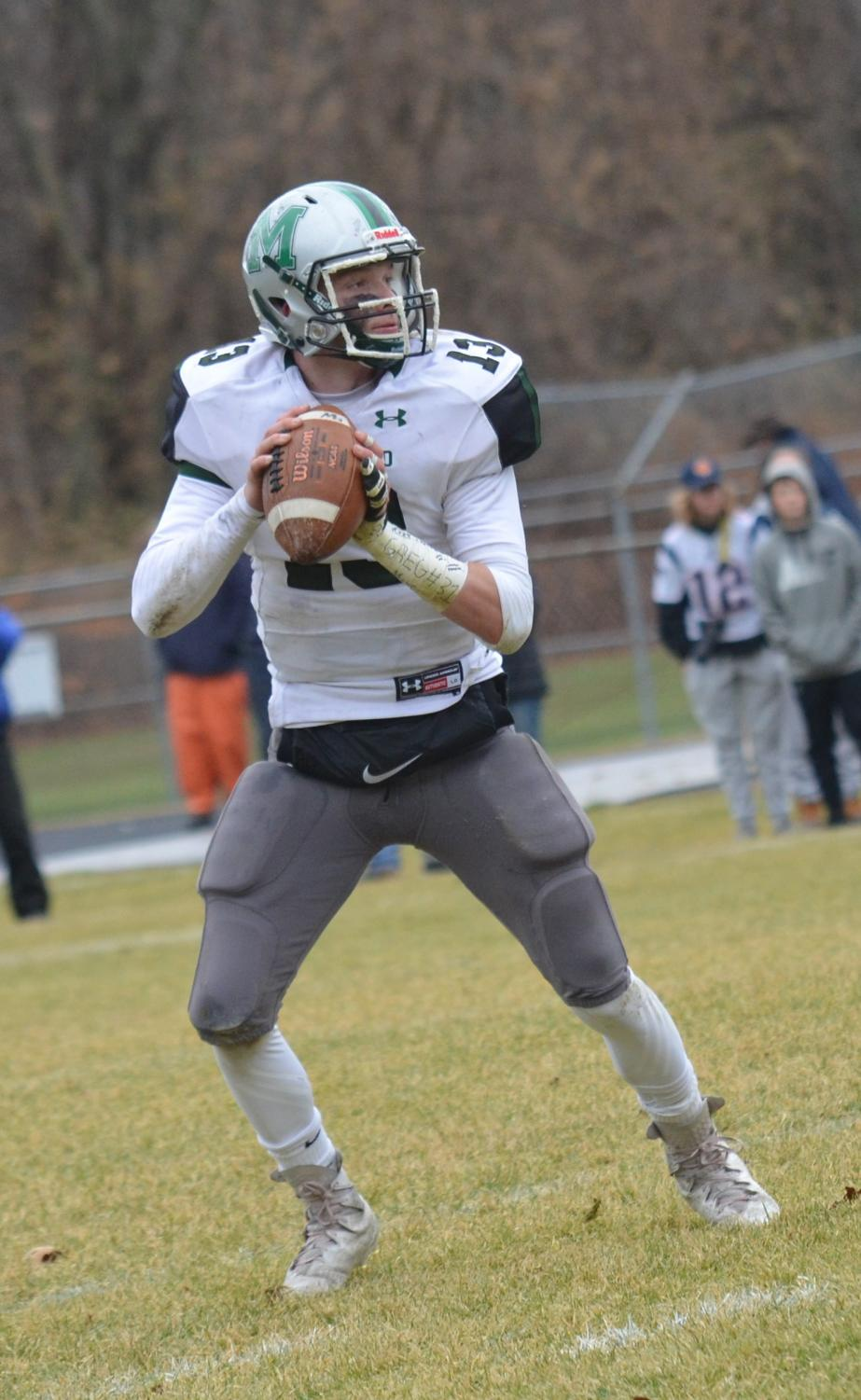 Jack Moussette surveys the field looking for an open receiver in a Thanksgiving Day win against Foxborough