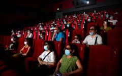 Masks and social distancing are required when going to the movies    Photo Courtesy: IndieWire